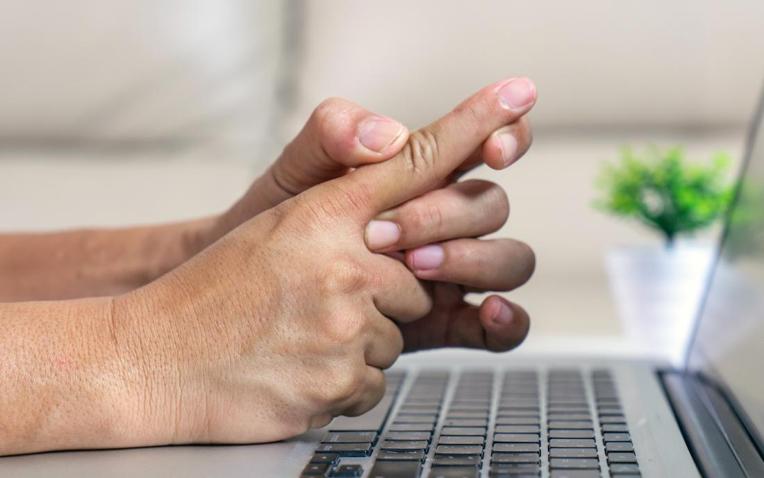 a person holding their finger because they have trigger finger.