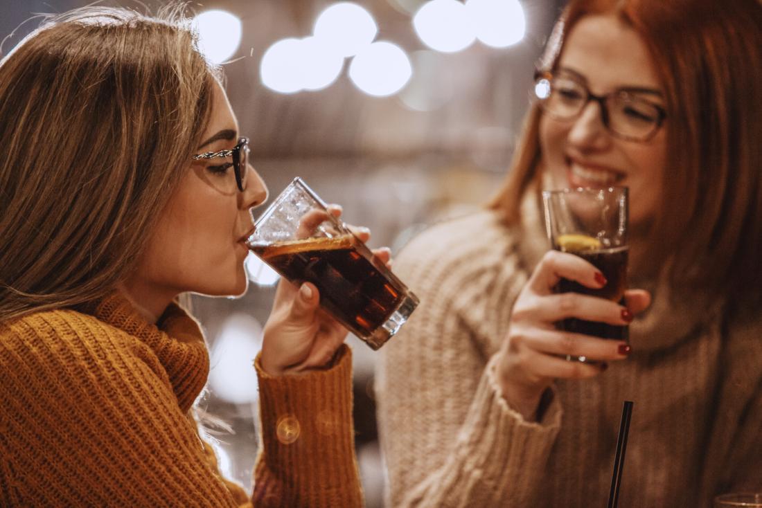 Women sharing soda