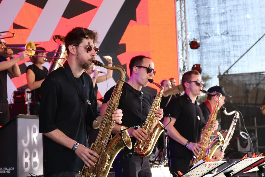 men playing saxophone in a brass band
