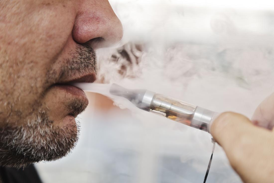 person using electronic cigarette
