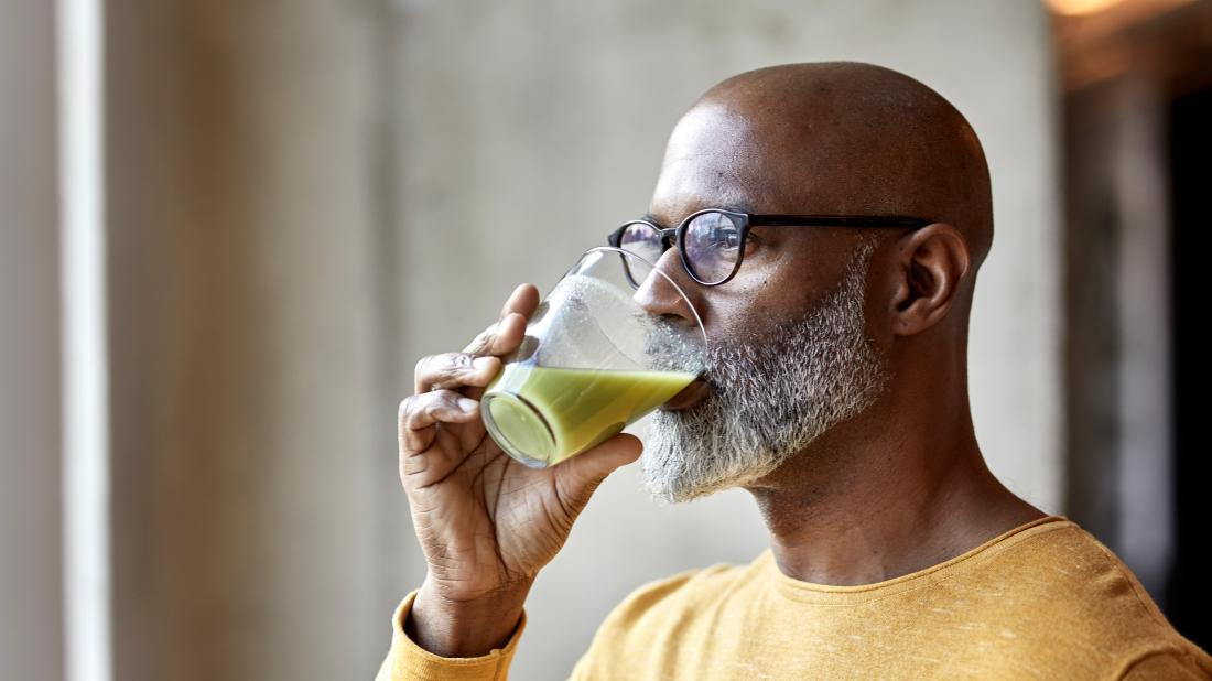 Full liquid diet: Everything you need to know -  a man drinking a smoothie as part of his full liquid diet