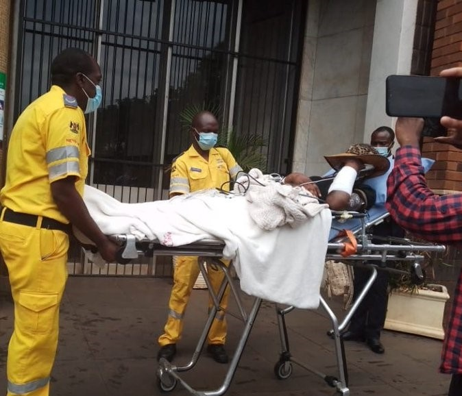 Mary Mabauwa carried to court on a stretcher.