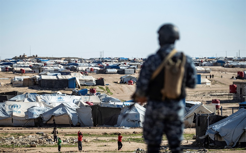 Special forces of the Syrian Democratic Forces keep watch on 30 March 2021 in the vicinity of al-Hol camp, the larger of two Kurdish-run displacement camps for relatives of Islamic State jihadists in Syrias northeast.