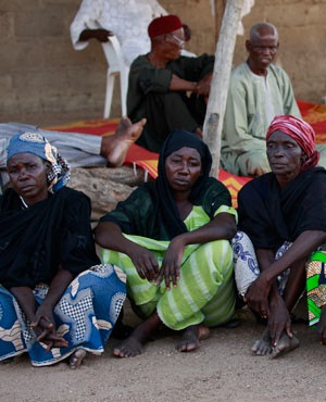 Parents of the kidnapped school girls sit outside a compound during a meeting in Chibok, Nigeria. (Sunday Alamba, AP, File)