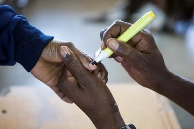 A voter gets his finger inked at a polling station