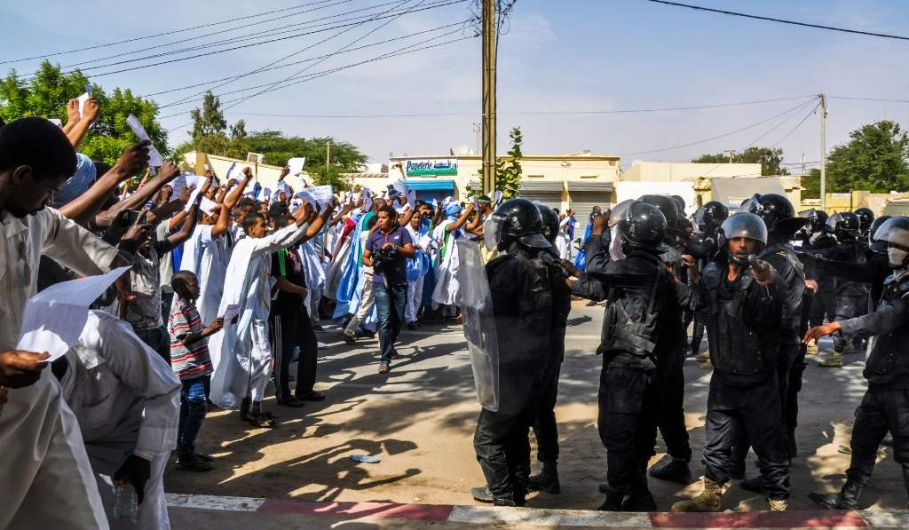 People face off with anti-riot police officers as they demonstrate on 10 November 2017 in Nouakchott, Mauritania.