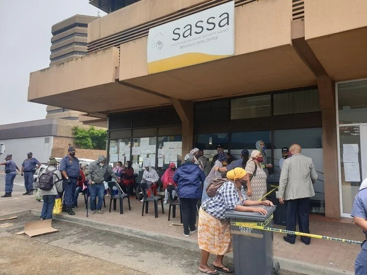 Applicants for renewal of disability grants queue outside the Bellville offices of the South African Social Security Agency last week. Photo: Mary-Anne Gontsana