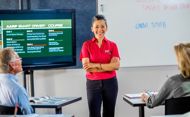 Female Aarp Smart Driver Volunteer Instructor In A Classroom