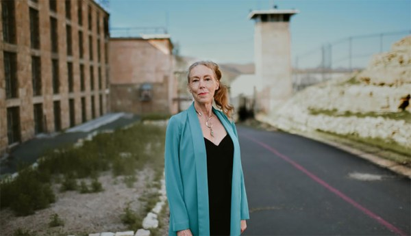 karen gedney standing outside of a prison