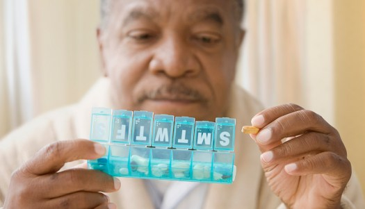Man looking at pills