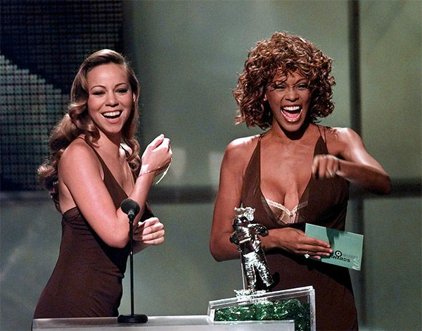 Sept. 1998: Mariah Carey, left, and Whitney Houston present the award for Best Male Video during the MTV Video Music Awards. <span class=meta>Photo/AP Photo</span>