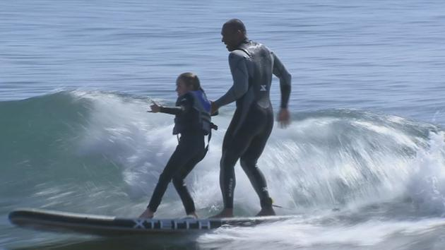 Surfing helps kids with cystic fibrosis overcome difficulties
