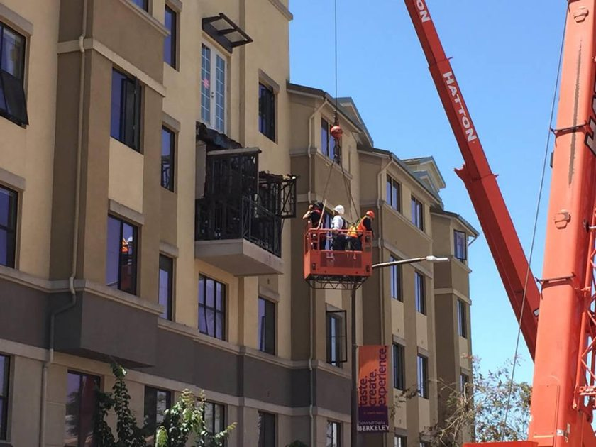 <div class='meta'><div class='origin-logo' data-origin='none'></div><span class='caption-text' data-credit='KGO-TV/Elissa Harrington'>Crews examine a balcony that collapsed and killed and injured several people in Berkeley, Calif. on June 16, 2015.</span></div>