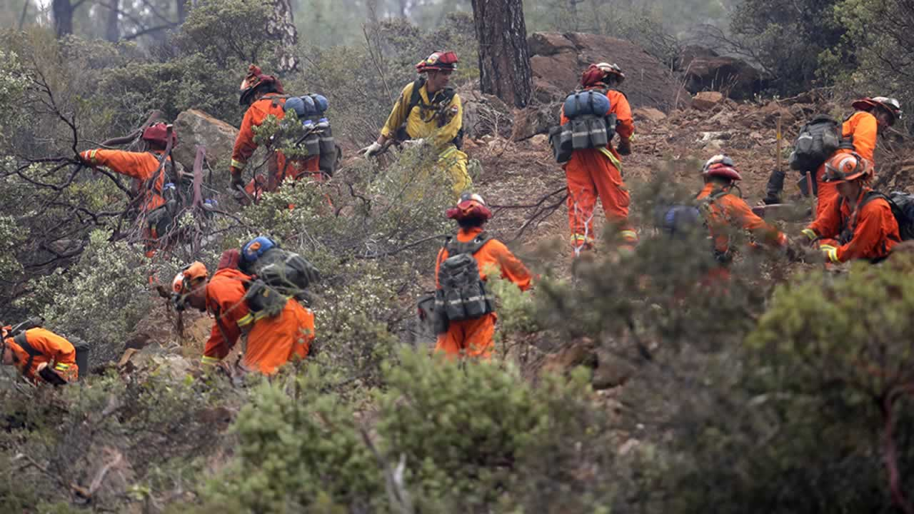 Firefighters work on a ridge line as they clear brush Monday, Sept. 14, 2015, near Middletown, Calif. <span class=meta>AP Photo/Elaine Thompson</span>