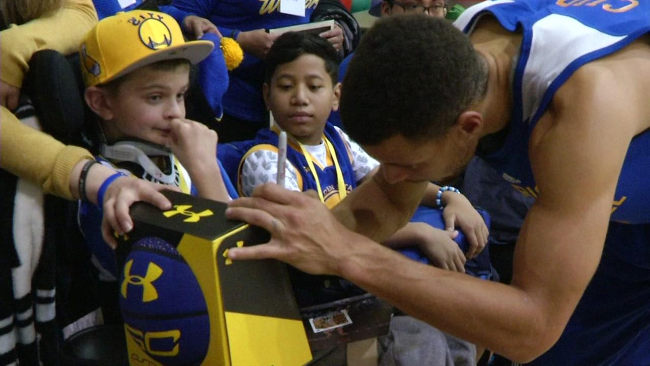 Image result for steph curry signing shoes for fans