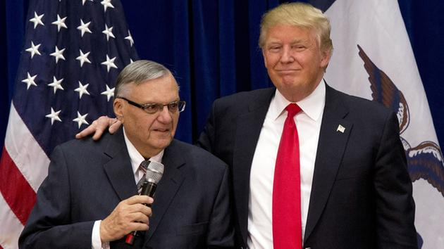 In this Jan. 26, 2016, file photo, then-Republican presidential candidate Donald Trump is joined by Joe Arpaio, the sheriff of metro Phoenix.