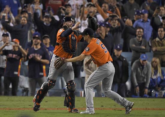 """<div class='meta'></img><div class='origin-logo' data-origin='AP'></div><span class='caption-text' data-credit='AP'>Houston Astros catcher Brian McCann and starting pitcher Charlie Morton celebrate after win against the Los Angeles Dodgers in Game 7. (AP Photo/Mark J. Terrill)</span></div>"""" data-rstmb=""""http://cdn.abclocal.go.com/content/ktrk/images/cms/11012017KTRKapastrosdodgersgame7celebration01.jpg""""></figure><div class="""