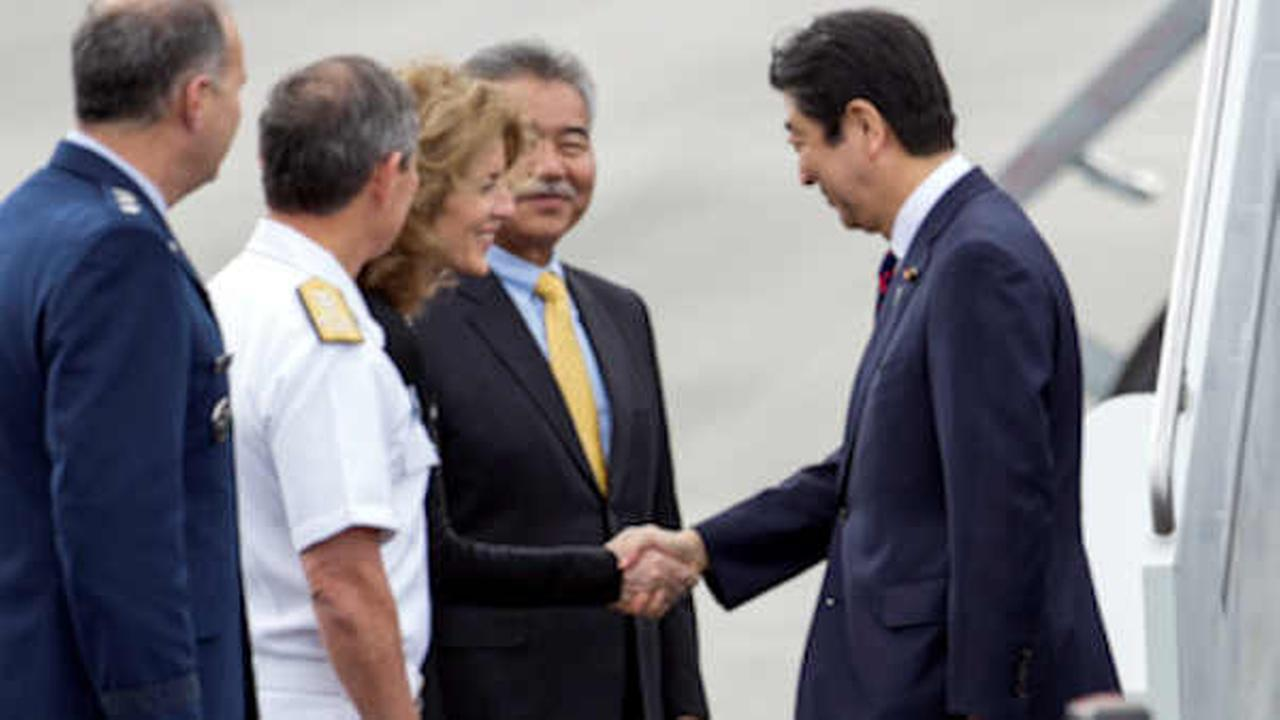 Image result for images of Obama and Abe meet at Pearl Harbor on Dec. 27, 2016