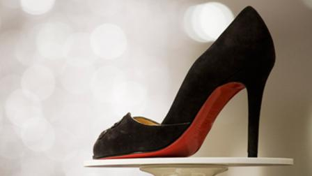 A stiletto-heeled shoe by Christian Louboutin is displayed at the opening of Saks Fifth Avenues designer shoe floor on Friday, Aug. 17, 2007 in New York. The pair of shoes is $850. Saks Inc.