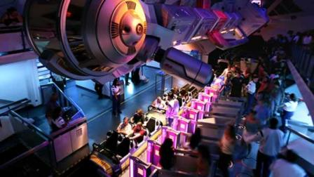 Guests line up to ride Disneylands Space Mountain attraction Friday, July 15, 2005, in Anaheim, Calif.