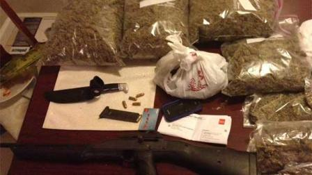 While trying to serve an arrest warrant in northwest Harris County on Thursday, deputies discovered approximately 7 pounds of marijuana, 3.2 pounds of cocaine, 1.5 grams of methamphetamine, an assault rifle and various scales.