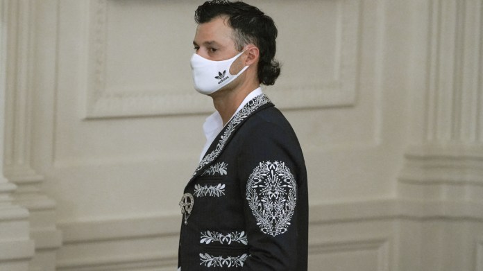 Dodgers pitcher Joe Kelly dons mariachi jacket he traded for his jersey at White House ceremony