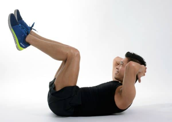 Raised-leg crunches are a variation on the simple sit-up that strengthens your core muscles.