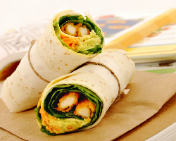 Wraps filled with avacado and vegetables are the foundation of a delicious and healthy homemade lunch for your child. Photo: iStock Photo. healthy natural school lunch kids children stainless-steel plastic nitrates preservatives junk homemade sodium sugar artificial-ingredients organic fruit vegetables hummus wraps pitas sandwiches salads pizza parents drinks bpa bisphenol-a