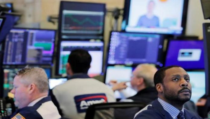 Traders trading on Wall Street - Reuters