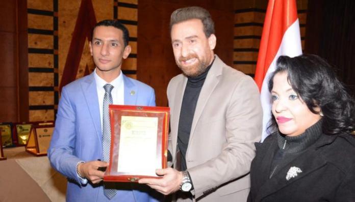 Nidal Al-Shafi'i while receiving an honorary doctorate