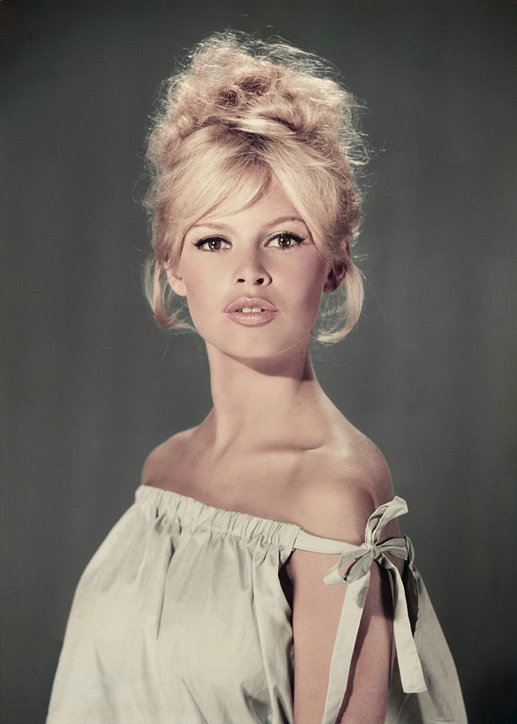 Portrait of actress and model Brigitte Bardot wearing a light blue off-the-shoulder dress.  |  Photo: Getty Images
