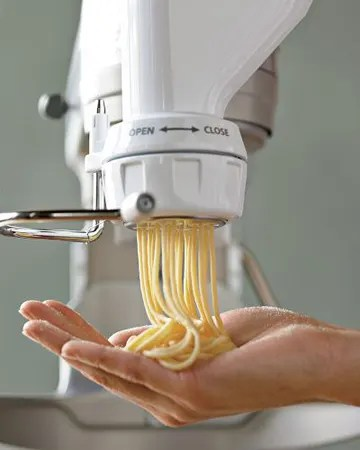 kitchen aid pasta dark cherry cabinets tool crush kitchenaid press attachment kitchn now has an for their mixers that lets us make shaped at home we re talking fresh spaghetti fusilli and rigatoni folks