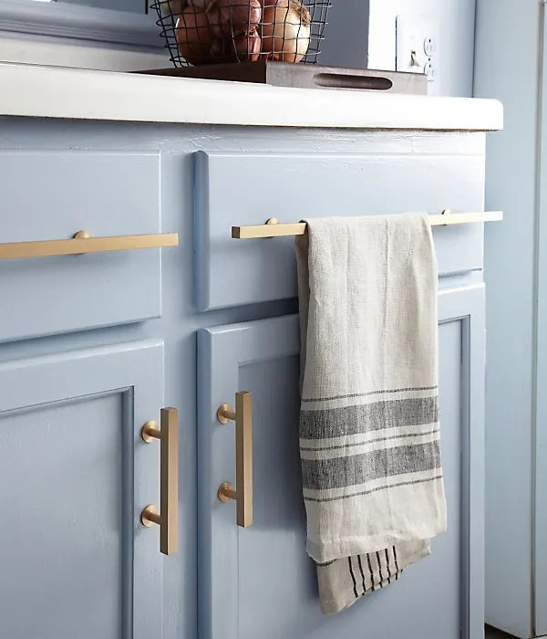 brass kitchen pulls delta talbott faucet details brushed cabinet against light blue i don t know what jumped out at me first when saw this photo the absolutely perfect shade of grayish on cabinets elegant