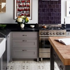 Soapstone Kitchen Cabinet Glass Inserts Countertops Pros And Cons To Consider Apartment Therapy A Dark Countertop Provides Lovely Contrast Grey Cabinets In This By Red Design Studio