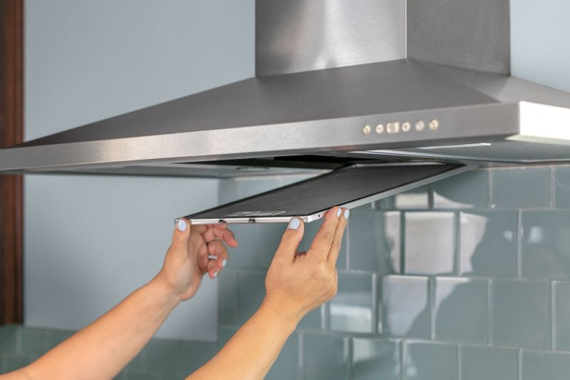kitchen hood filters mobile islands how to clean a greasy range filter kitchn remove the from most should easily slide or pop out of underside mine had metal loop i could grab push