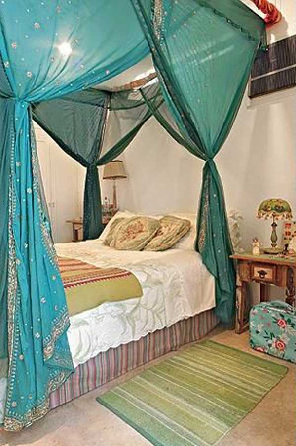 Soften a crisp white bedroom design with sheer white drapes on a canopy bed. 20 Magical DIY Bed Canopy Ideas Will Make You Sleep