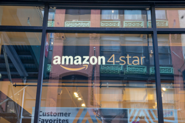 "Photo of a window sign that says ""Amazon 4-star"""
