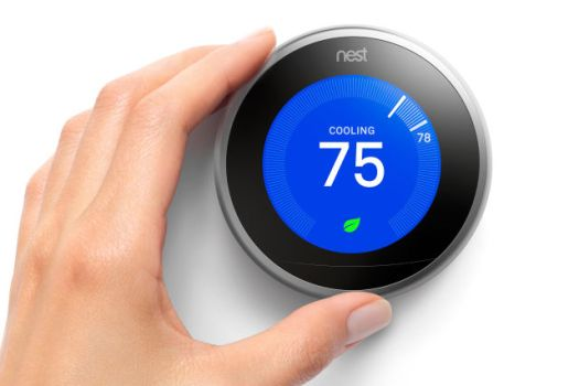 Promotional image of a hand adjusting a digital thermostat.