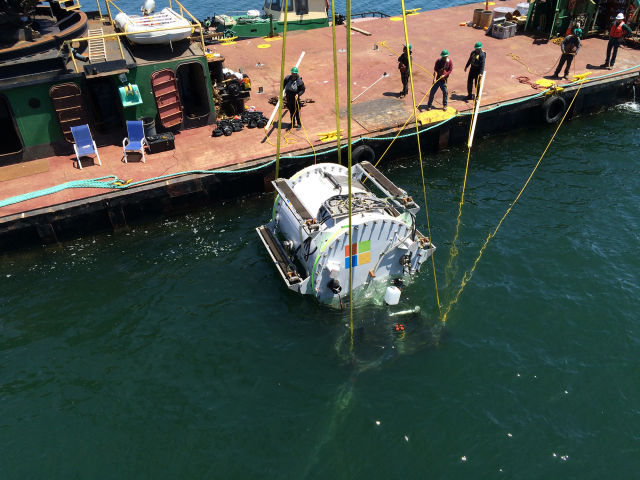 Lowering <em>Leona Philpot</em>, Microsoft's first underwater serverpod, into the water.