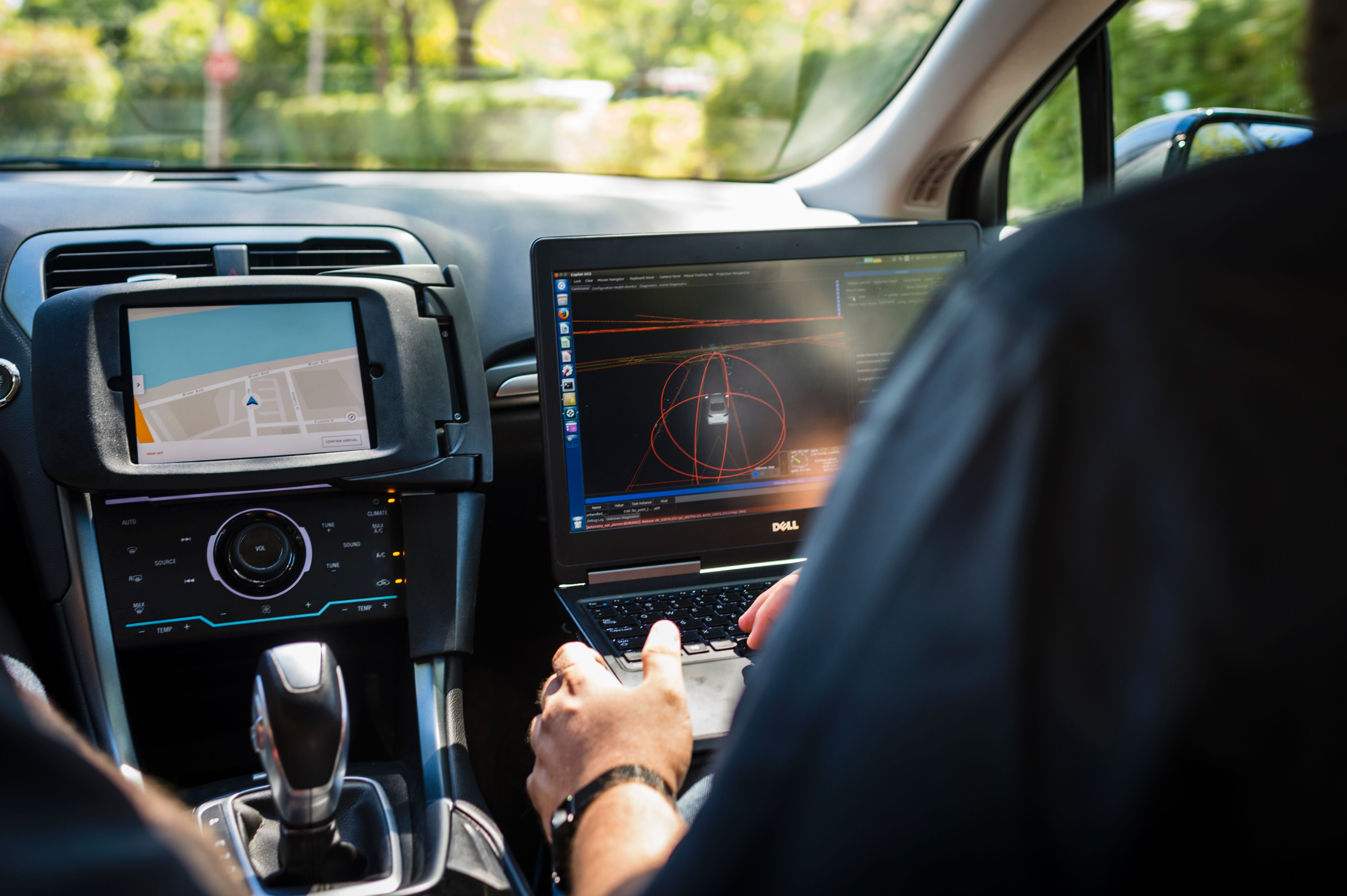 A technician sits in an Uber self-driving car on September 13, 2016 in Pittsburgh, Pennsylvania.