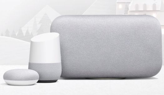 Three different Google Home smart speakers sitting next to each other on a table.