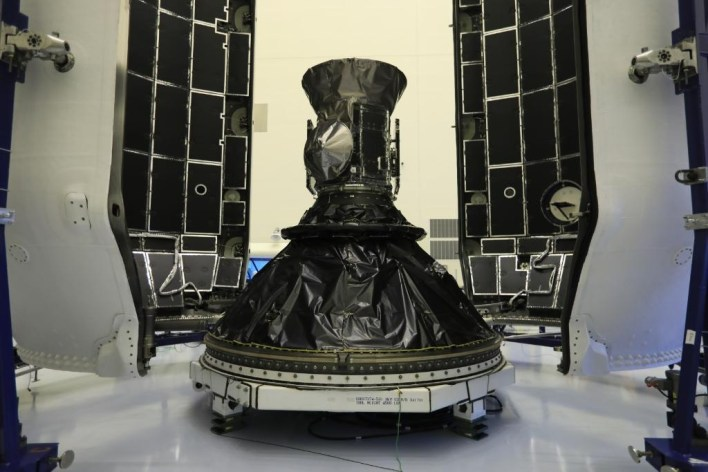 The small, refrigerator-sized TESS spacecraft inside the Falcon 9 rocket payload fairing.