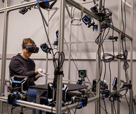 On Monday, Oculus chief scientist Michael Abrash posted this image of Facebook CEO Mark Zuckerberg testing <em>something</em> at what was formerly known as Oculus Research. Now, these tests take place at Facebook Reality Labs.