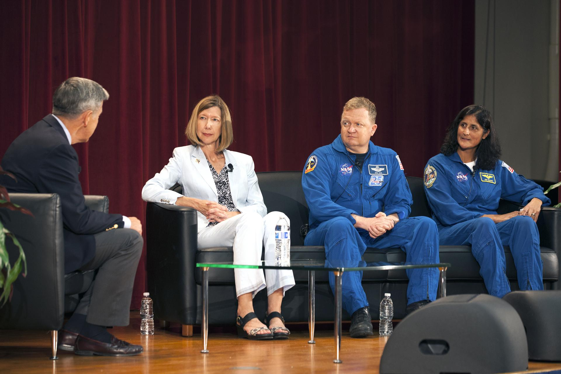 Kathy Lueders, center, has managed NASA's commercial crew program since 2014.