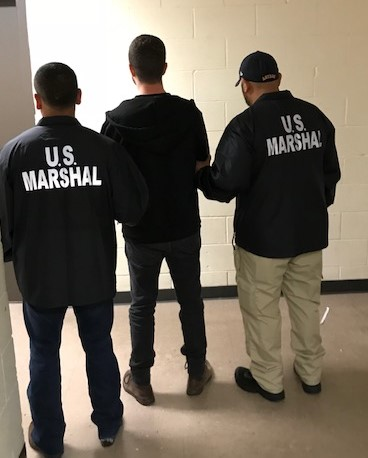 US Marshals shared this image of Wilson arriving into custody in Houston.