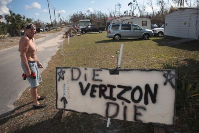 A Florida man sets up a sign that says,