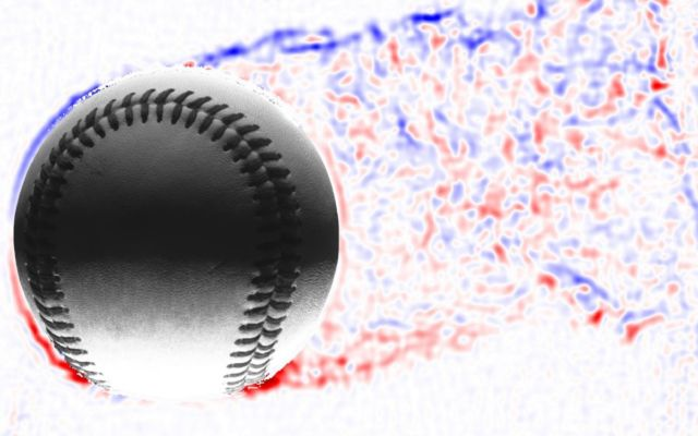 A knuckleball pitch is moving to the left, leaving a wake trailing behind to the right. The blue-colored air is rotating clockwise; the red air is rotating counterclockwise.