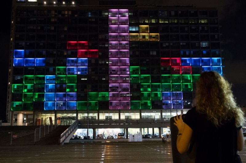 A giant Tetris board illuminating the windows of the Tel Aviv-Yafo Municipality in 2016. Playing Tetris provides a useful distraction during anxious waiting periods.