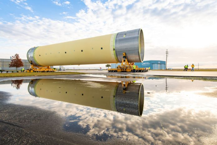 Technicians at NASA's Michoud assembly site in New Orleans moved the Space Launch System's liquid hydrogen tank from the factory to the dock, where it was loaded onto the Pegasus barge on December 14, 2018.