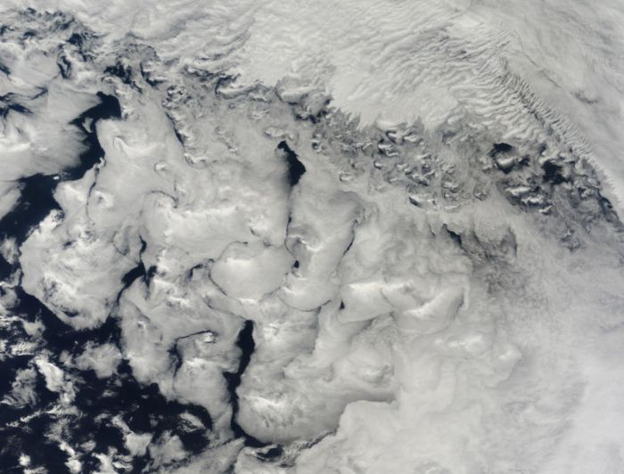 Stratocumulus clouds, like those in the lower two-thirds of this image, are common over the oceans.